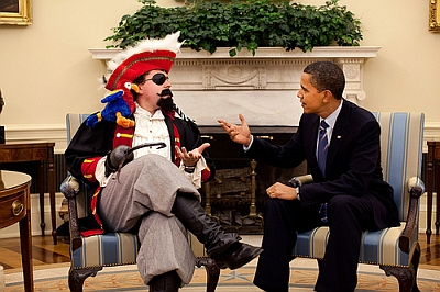 "Obama: ""A pirate walks into a bar..."" Pirate: ""With all due respect, Mr. President, I've had my fill of pirate jokes."""